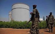 South Sudanese soldiers guard an oil refinery in Melut, Upper Nile State, South Sudan on November 20, 2012. South Sudan has restarted oil production, ending a 15-month bitter row with former civil war foe Sudan and marking a major breakthrough in relations after bloody border clashes last year