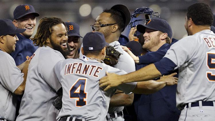 Detroit Tigers players celebrate following a baseball game against the Kansas City Royals at Kauffman Stadium in Kansas City, Mo., Monday, Oct. 1, 2012. The Tigers defeated the Royals 6-3 and clinched the AL Central title. (AP Photo/Orlin Wagner)