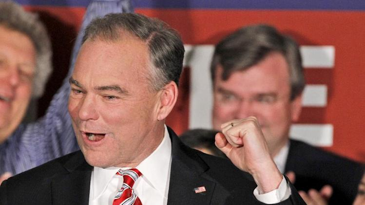 FILE - In this Nov. 6, 2012 file photo, Sen.-elect Timothy Kaine, D-Va. celebrates his win, in Richmond, Va. (AP Photo/Steve Helber, File)