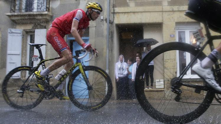 Cofidis team rider Rein Taaramae of Estonia cycles through a rain storm during the 208.5km 19th stage of the Tour de France cycling race