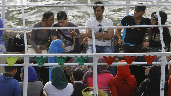An Egyptian woman dances as others enjoy a Nile River cruise in Cairo, Egypt, Tuesday, June 4, 2013.  Politicians meeting with Egypt's president on Monday proposed hostile acts against Ethiopia, including backing rebels and carrying out sabotage, to stop it from building a massive dam on the Nile River upstream.(AP Photo/Amr Nabil)