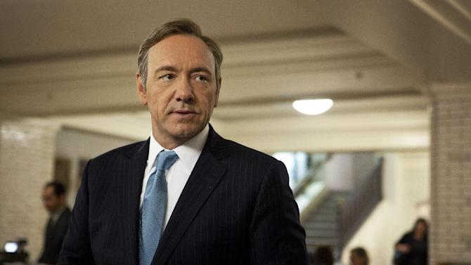 "This image released by Netflix shows Kevin Spacey as U.S. Congressman Frank Underwood in a scene from the Netflix original series, ""House of Cards."" Spacey was nominated for an Emmy Award for best actor in a drama series on, Thursday July 18, 2013. The Academy of Television Arts & Sciences' Emmy ceremony will be hosted by Neil Patrick Harris. It will air Sept. 22 on CBS. (AP Photo/Netflix, Melinda Sue Gordon)"
