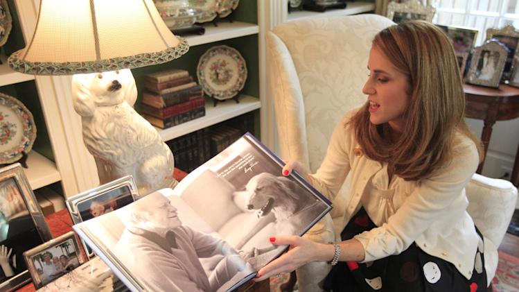 "In this photo made Tuesday, Oct. 16, 2012, Jennifer B. Pickens shows her  book titled ""Pets at the White House,"" during an interview at her home in Dallas.  Pickens compiled stories and photos of pets that lived in the White House for her latest book. (AP Photo/LM Otero)"
