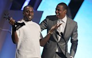 Kanye West, left, and Jay-Z accept the award for best group for &quot;The Throne&quot; at the BET Awards on Sunday, July 1, 2012, in Los Angeles. (Photo by Matt Sayles/Invision/AP)