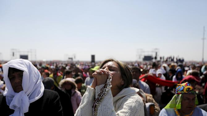People participte in a Pope Francis's Mass for a crowd of hundreds of thousands in Ecatepec, Mexico