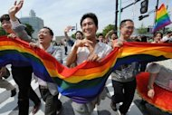 Participants carry a rainbow flag during a Gay Pride event in Tokyo's Shibuya district in April 2012. Some 1,000 gays, lesbians and their supporters took part in the parade