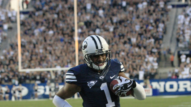 Brigham Young wide receiver Ross Apo (1) carries the ball in for a touchdown in the second quarter of an NCAA college football game against Hawaii Friday, Sept. 28, 2012, in Provo, Utah.  (AP Photo/Rick Bowmer)
