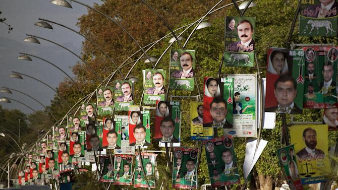 Roads in Islamabad are decorated with poster of candidates taking part in next month's parliamentary elections in Islamabad, Pakistan, Monday, April 29, 2013. Candidates restricted their election campaigns to corner meetings and social media due to ongoing attacks by Taliban on their offices and rallies of various political parties. (AP Photo/B.K. Bangash)