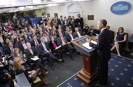 Reporters listen to U.S. President Barack Obama speak about the sequester after he met with congressional leaders at the White House in Washington