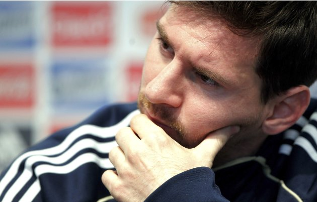 Argentina's Lionel Messi gestures during a news conference at the squad's headquarters in Buenos Aires