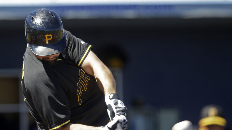 Pittsburgh Pirates catcher Tony Sanchez hits and RBI double in the first inning of a exhibition baseball game against the Tampa Bay Rays in Port Charlotte, Fla., Saturday, March 8, 2014. The Pirates won 10-5