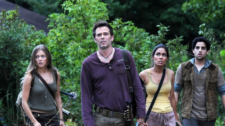 """FILE - This undated publicity image released by NBC shows, from left, Tracy Spiridakos as Charlie Matheson, Billy Burke as Miles Matheson, Daniella Alonso as Nora, and Paras Patel as Albert, in a scene from """"Revolution."""" The series by J.J. Abrams tells of a world 15 years after the world inexplicably suffers a power outage. On Monday, Nov. 19, Led Zeppelin's """"Kashmir"""" and """"Since I've Been Loving You"""" will be featured in next week's episode, the same day, Led Zeppelin's """"Celebration Day"""" album and a companion documentary on DVD will be released. (AP Photo/NBC, Brownie Harris, File)"""