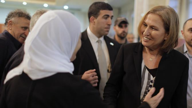Former cabinet minister Livni greets supporters during a conference to address the Israeli Arab public ahead of the general election, in Shfaram