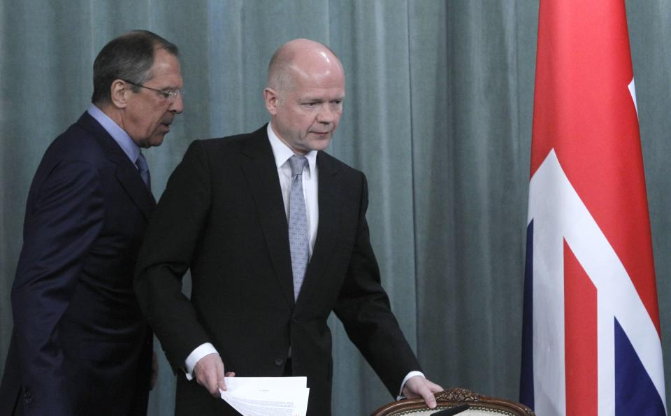 Russian Foreign Minister Sergey Lavrov, left, and his British counterpart William Hague walk to a press conference after their meeting in Moscow, Russia, Monday, May 28, 2012. (AP Photo/Misha Japaridze)