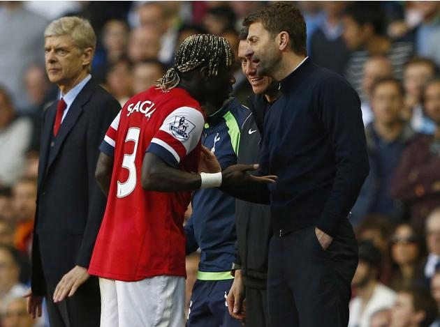 Arsenal's Sagna reacts after he was hit by a ball thrown by Tottenham Hotspur's manager Sherwood during their English Premier League soccer match in London