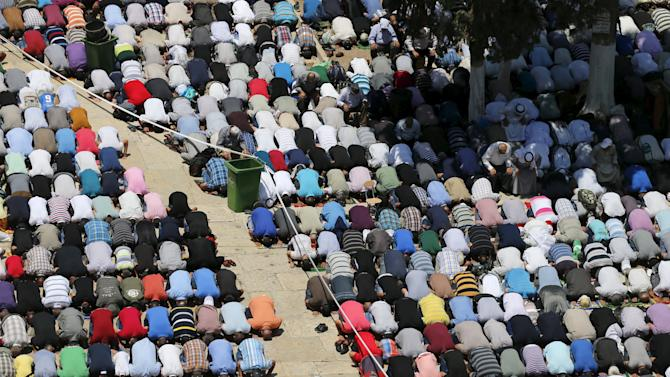 Palestinian men pray on the third Friday of the holy month of Ramadan in Jerusalem's Old City