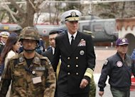 U.S. Admiral Samuel Locklear (C), Commander of the U.S. Pacific Command, is accompanied by Shigeru Iwasaki (R), Chief of Japan&#39;s Self-Defence Forces Joint Staff, as he arrives to inspect the Patriot Advanced Capability-3 (PAC-3) land-to-air missile deployed at the Defence Ministry in Tokyo April 11, 2012. REUTERS/Yuriko Nakao