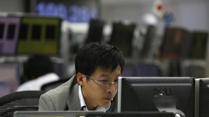Employee of a foreign exchange trading company looks at monitors in Tokyo