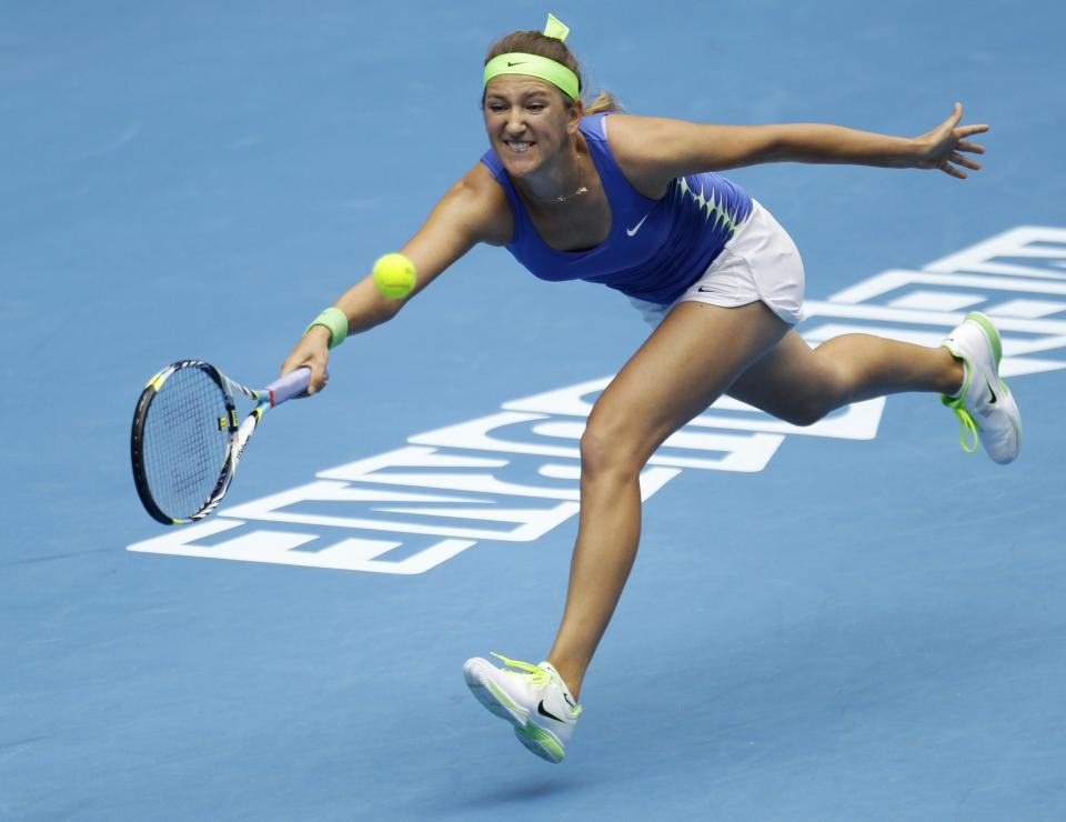 Victoria Azarenka of Belarus reaches for a forehand return to Germany's Mona Barthel during their third round match at the Australian Open tennis championship, in Melbourne, Australia, Friday, Jan. 20, 2012. (AP Photo/Sarah Ivey)