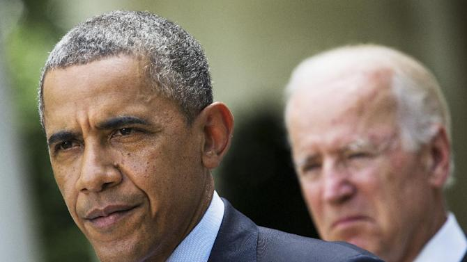 FILE - In this June 30, 2014, file photo, President Barack Obama, accompanied by Vice President Joe Biden, pauses while making a statement about immigration reform, in the Rose Garden of the White House in Washington. Obama over time has been embraced and scorned by immigrant advocates who have viewed him as both a champion and an obstacle to their cause. (AP Photo/Jacquelyn Martin, File)