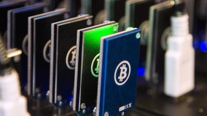 Chain of block erupters used for Bitcoin mining is pictured at the Plug and Play Tech Center in Sunnyvale, California