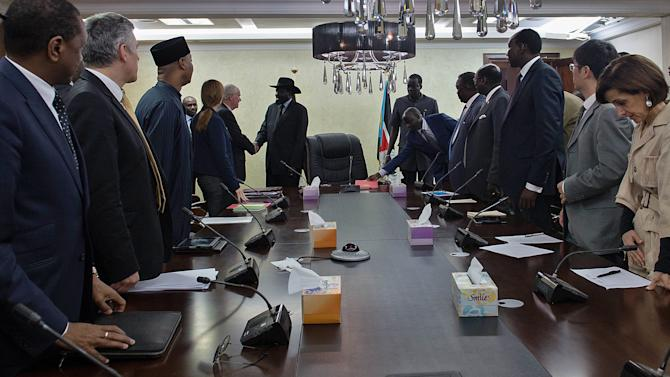 United Nations (UN) Security Council members attend a meeting with South Sudan's President Salva Kiir (C) and members of his cabinet August 12, 2014 in Juba