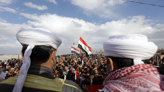 FILE - In this file photo taken in Wednesday, Jan. 9, 2013, protesters chant slogans against Iraq's Shiite-led government as they wave national flags during a demonstration in Ramadi, 70 miles (115 kilometers) west of Baghdad, Iraq. The Sunni tribesmen camped out on the edge of this one-time Iraqi insurgent stronghold are digging in and growing more organized, vowing to keep up their protests against a Shiite-led government they feel has left them behind. (AP Photo/ Khalid Mohammed, File)