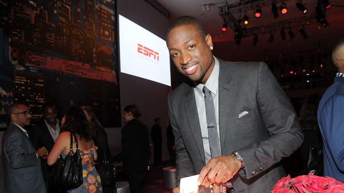 """NBA champion and Miami Heat shooting guard Dwyane Wade signs a copy of his first book """"A Father First: How My Life Became Bigger Than Basketball,"""" at a party hosted by ESPN The Magazine, Tuesday, Sept. 4, 2012, at Jazz at Lincoln Center in New York. (Diane Bondareff/Invision for ESPN The Magazine/AP Images)"""