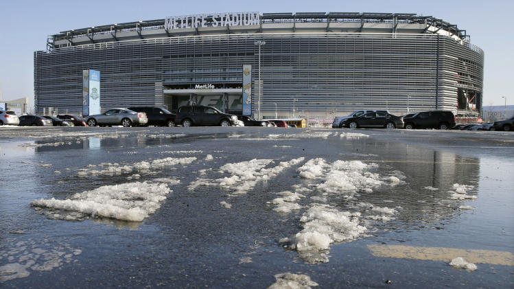 Snow and slush left from Tuesday's snowfall is seen outside MetLife stadium in East Rutherford, N.J., Wednesday, Dec. 18, 2013. Later Wednesday, at MetLife, officials demonstrated snow removal and melting machinery and outlined emergency weather scenarios and contingency plans for the Super Bowl in February. (AP Photo/Mel Evans)