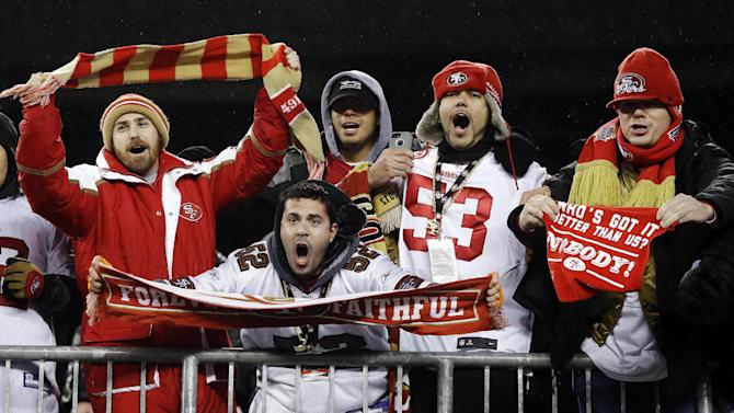 San Francisco 49ers fans celebrate their team's 41-34 win over the New England Patriots in an NFL football game in Foxborough, Mass., Monday, Dec. 17, 2012. (AP Photo/Elise Amendola)