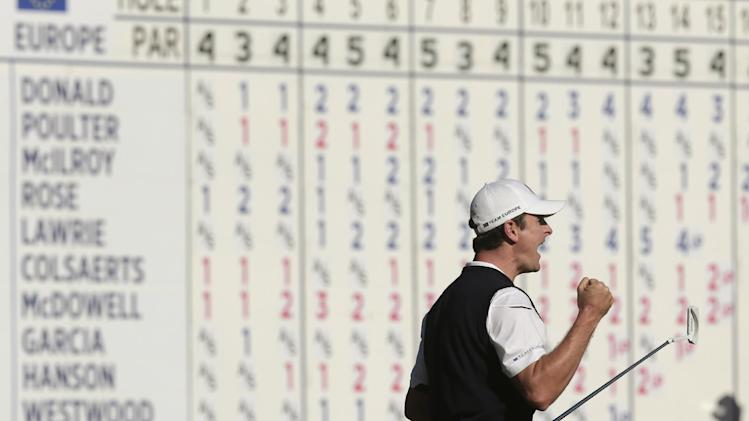Europe's Justin Rose reacts after defeating USA's Phil Mickelson on the 18th hole during a singles match at the Ryder Cup PGA golf tournament Sunday, Sept. 30, 2012, at the Medinah Country Club in Medinah, Ill. (AP Photo/Charlie Riedel)