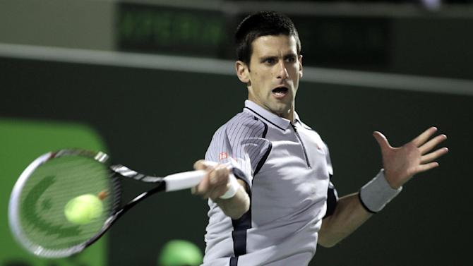 Novak Djokovic, of Serbia, returns the ball to Tommy Haas, of Germany, at the Sony Ericsson Open tennis tournament in Key Biscayne, Fla., Tuesday, March 26, 2013. (AP Photo/Luis M. Alvarez)