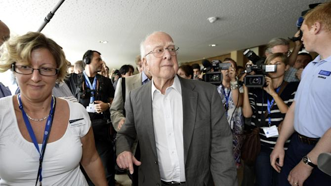 "British physicist Peter Higgs arrives for a press conference about the latest update in the search for the Higgs boson at the European Organization for Nuclear Research (CERN) in Meyrin near Geneva, Switzerland, Wednesday, July 4, 2012. The head of the world's biggest atom smasher is claiming discovery of a new particle that he says is consistent with the long-sought Higgs boson known popularly as the ""God particle"" which is believed to give all matter in the universe size and shape. (AP Photo/Keystone/Martial Trezzini)"