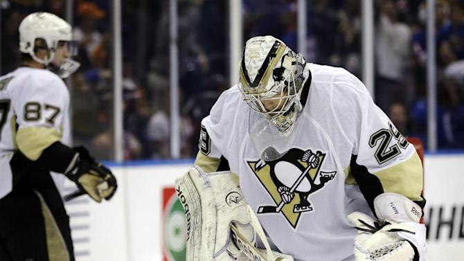 Pittsburgh Penguins goalie Marc-Andre Fleury (29) and center Sidney Crosby (87) react after New York Islanders right wing Kyle Okposo scored a goal in the second period of Game 4 of their first-round NHL hockey Stanley Cup playoffs hockey series at Nassau Coliseum in Uniondale, N.Y., Tuesday, May 7, 2013. The Islanders won 6-4. (AP Photo/Kathy Willens)