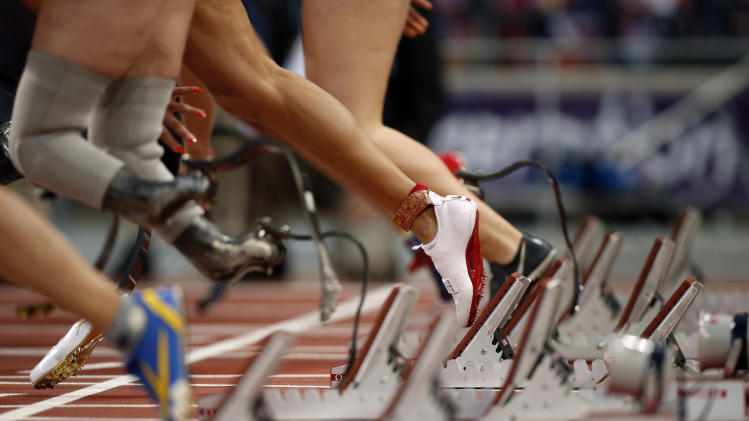 The shoe and ankle bracelet of April Holmes of the U.S. come off the blocks as she makes a start during a women's 100m T44 round 1 race at the 2012 Paralympics in London, Saturday, Sept. 1, 2012.  (AP Photo/Matt Dunham)