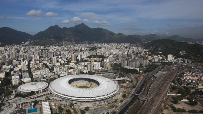 FILE - This April 11, 2013 file photo, shows the new rooftop of the Maracana Stadium, which is undergoing renovations in preparation for the 2013 Confederations Cup and 2014 World Cup in Rio de Janeiro, Brazil.   The action at the Confederations Cup will be going from the nation's capital to the coastal cities in the northeast to the beaches of Rio de Janeiro. Six cities will stage matches at the World Cup warm-up tournament from June 15-30, with the capital of Brasilia hosting the opener in a new stadium and the renovated Maracana Stadium holding the final on June 30.(AP Photo/Felipe Dana, File)