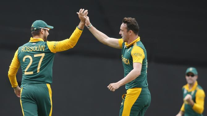 South Africa's Kyle Abbott celebrates dismissing Pakistan's Ahmed Shahzad during their Cricket World Cup match in Auckland