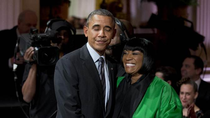 """President Barack Obama greets Patti LaBelle after she performed """"Over the Rainbow"""" during the """"In Performance at the White House: Women of Soul"""" in the East Room of the White House in Washington, Thursday, March 6, 2014, hosted by President Barack Obama, and first lady Michelle Obama. The program included performances by Tessanne Chin, Melissa Etheridge, Aretha Franklin, Ariana Grande, Janelle Monáe and Jill Scott. (AP Photo/Manuel Balce Ceneta)"""