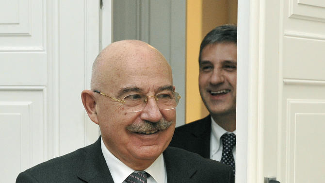 Austria's Foreign Minister Michael Spindelegger, right, welcomes his Hungarian counterpart Janos Martonyi, in Vienna, Austria, on Wednesday, Dec. 5, 2012. (AP Photo/Hans Punz)