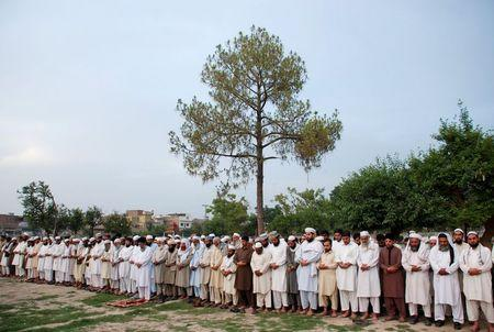 Men and students from Ghausia Madrassa gather at Wazir Bagh in Peshawar to offer prayers for two people who were killed by police in Texas