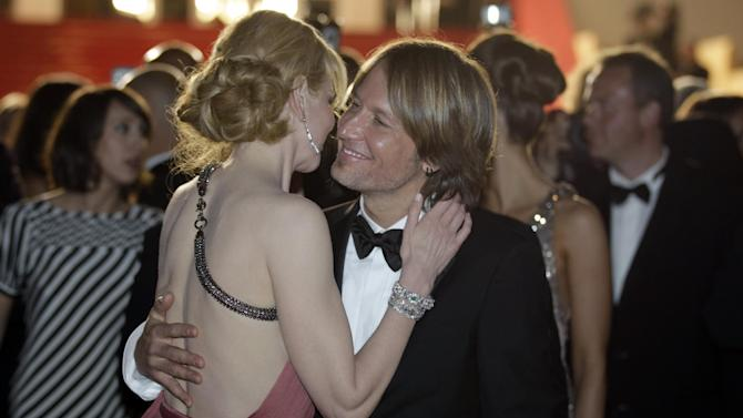 Actress Nicole Kidman, left, and musician Keith Urban embrace as they depart following the screening of The Paperboy at the 65th international film festival, in Cannes, southern France, Thursday, May 24, 2012. (AP Photo/Lionel Cironneau)