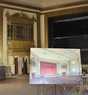 This Nov. 17, 2012 photo shows an artist rendering of the eventual restoration of the State Theatre on an easel inside the Sioux Falls, S.D., theater. The circa-1926 theater, closed since 1991, has been raising funds for its renovation and plans to begin showing movies again in 2013. (AP Photo/Dirk Lammers)3