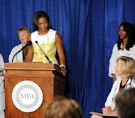 First lady Michelle Obama talks at an event last year about the Affordable Care Act. Getty Images