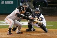 Brandon Crawford of the San Francisco Giants hits a sacrifice bunt against Phil Coke of the Detroit Tigers in the tenth inning during Game Four of the Major League Baseball World Series at Comerica Park on October 28, 2012 in Detroit, Michigan
