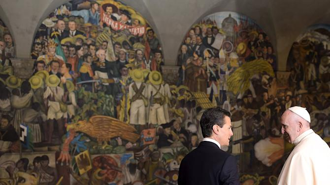 Handout of Pope Francis and Mexico's President Pena Nieto observing Diego Rivera's mural depicting Mexico's history at the National Palace in Mexico City