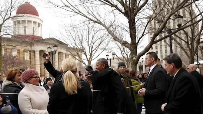 U.S. President Obama receives a hug in front of the Old State Capitol during a visit to Springfield