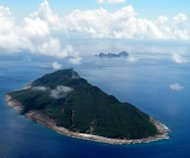View of the disputed islands (known as Senkaku in Japan and Diaoyu in China) in the East China Sea. Chinese ships have plied the waters of a disputed island chain, Japan&#39;s coastguard said, as a fleet of Taiwanese fishing boats set sail for the area, vowing to stake Taipei&#39;s claim