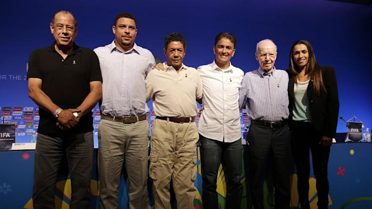 FIFA World Cup ambassadors, from left; Carlos Alberto, Ronaldo, Amarildo, Bebeto, Zagallo, and Marta pose for a photo after a press conference in Salvador, Brazil, Thursday, Dec. 5, 2013. The draw for the 2014 World Cup soccer finals takes place Friday, Dec. 6, in Costa do Sauipe, Brazil. (AP Photo/Andre Penner)