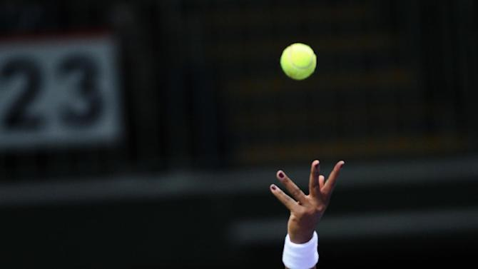 Serena Williams of the US prepares to serve to Na Li of China, during their tennis match on the second day of the WTA championship in Istanbul, Turkey, Wednesday, Oct. 24, 2012. (AP Photo)