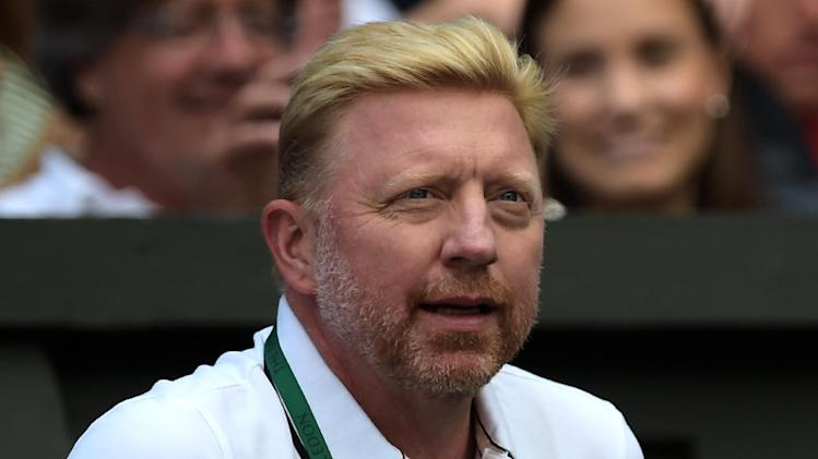 Boris Becker watches Novak Djokovic's third round match against Gilles Simon during the Wimbledon Championships at The All England Tennis Club in southwest London, on June 27, 2014